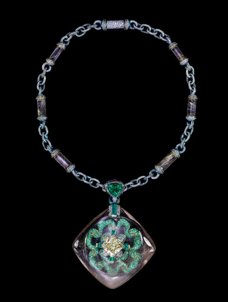 "The Wallace Chan ""Secret Abyss"" necklace has a yellow diamond of 10.05 cts set in a rutilated quartz shell of 211.74ct and complemented with emeralds, fancy colored diamonds, amethysts and rutilated quartz."