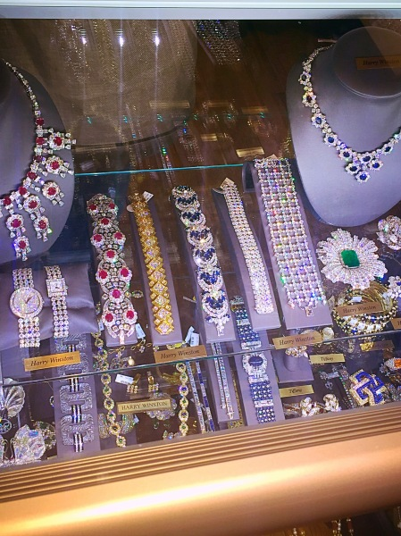 A display featuring a glittering array of pieces with classic charm. My favorite is the Art Deco emerald and diamond brooch.